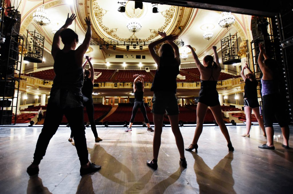 Students stretch under the direction of Laura Sheehy from Cabaret during a Broadway Master Class at Proctors Friday, May 12, 2017.