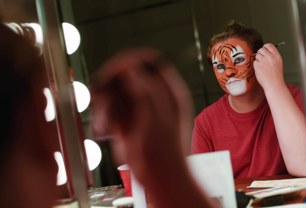 Students paint their faces in Stage and Special FX Makeup camp at Proctors Wednesday, July 19, 2017.
