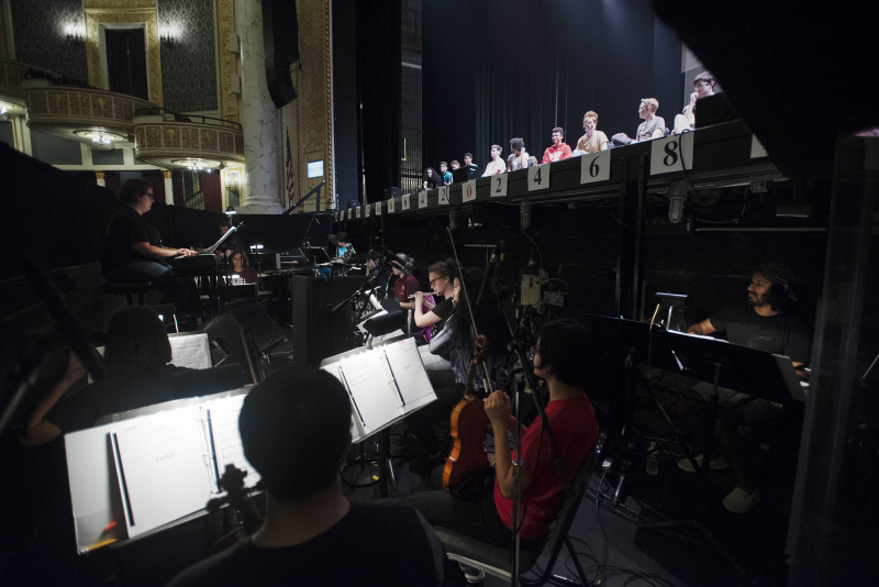 Broadway Camp: Musicians rehearse in the pit while actors sing on stage during rehearsal for Aida on Mainstage at Proctors Wednesday, August 1, 2018.
