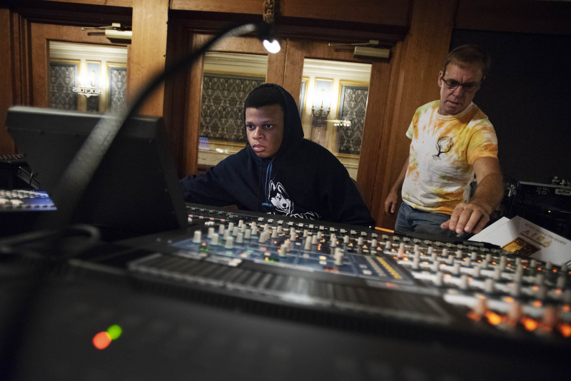 Students work with Proctors industry professionals to learn how to work the sound board during tech week of Broadway Camp on Mainstage at Proctors Monday, July 30, 2018.