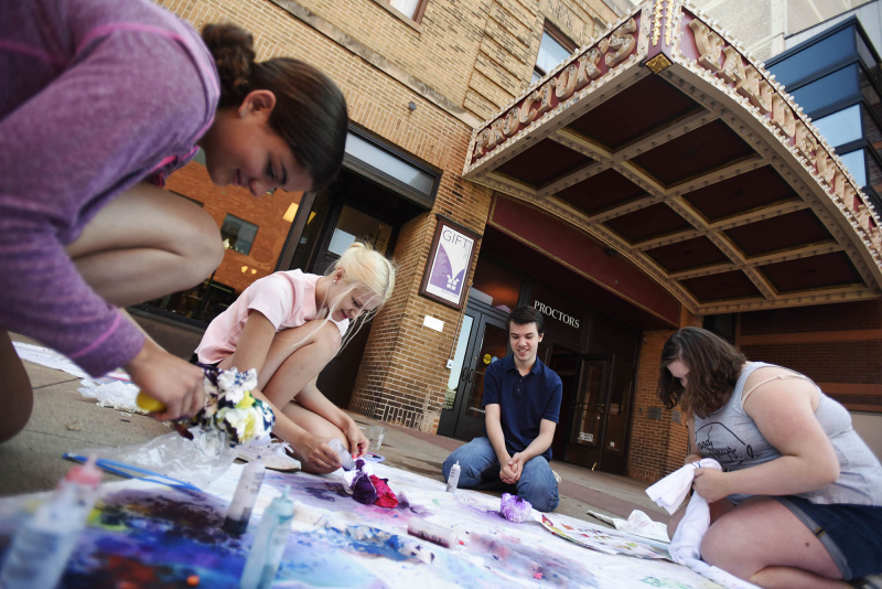 Broadway Camp students tie dye t-shirts on Stratton Plaza at Proctors Tuesday, June 9, 2019.