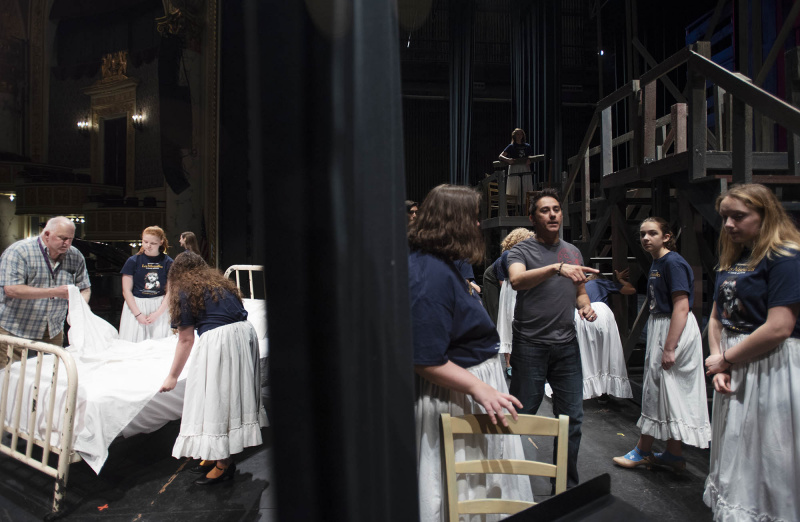 Broadway Camp director Steven Yuhasz, left, and choreographer Freddy Ramirez work wth students in the staging of Les Miserables on the MainStage at Proctors Frday, July 26, 2019.