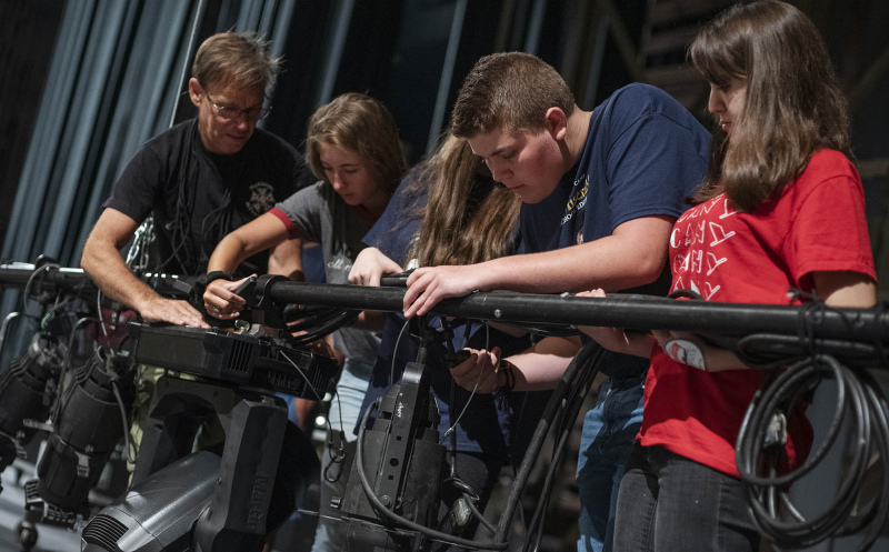 Broadway Camp Production students hang lights on the MainStage for Les Miserables at Proctors Friday, July 26, 2019.