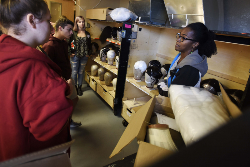 Denise Farrell, head of wigs and hair for The Color Purple, talks with Broadway Tech students about the Production in the wig room dressing room at Proctors in Schenectady Thursday, September 28, 2017.