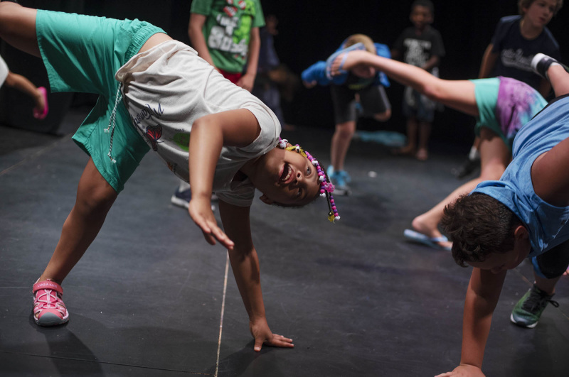 Students from Acting Out! do yoga with their teacher before rehearsing their skits in the Addy theatre Thursday, July 18, 2019.
