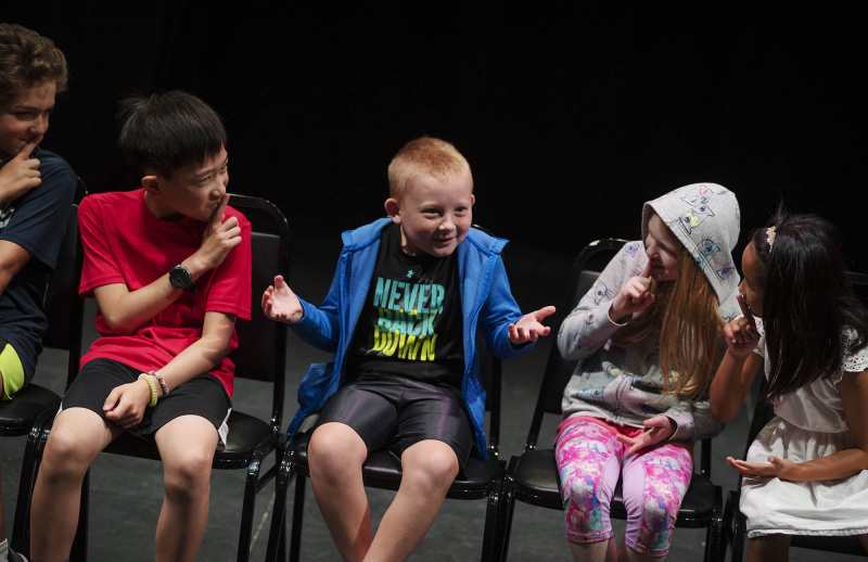Students from Acting Out! play a theatre game during camp in the Addy Thursday, July 18, 2019.