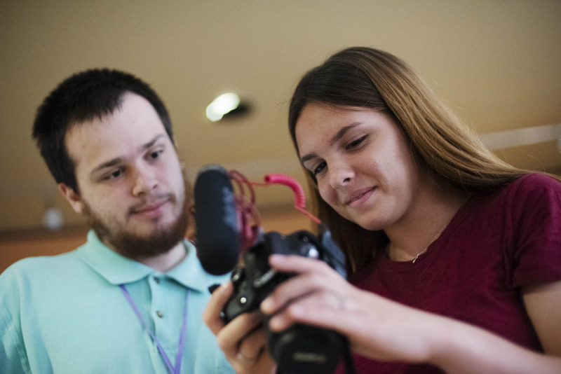 A filmmaking student sets up her camera before a shoot Thursday, July 18, 2019.