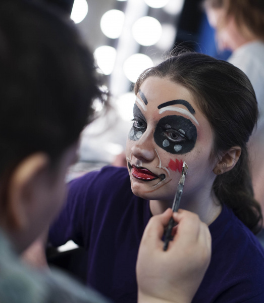 Students in Creating Effects: Advanced Makeup Techniques  paint their original designs on each other in the dressing rooms at Proctors Friday, July 26, 2019.
